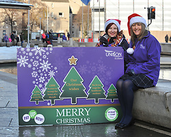 Pictured: Laura McDonald and Lillian Macer from UNISON with a giant Christmas card and cracker demanding fair pay for NHS workers.<br /> <br /> UNISON delivers 5000 'Fair Pay Now' cards to MSP's at the Scottish Parliament, demanding the Scottish Government 'pays up on NHS pay'.<br /> <br /> © Dave Johnston/ EEm