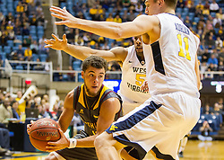 Nov 23, 2015; Morgantown, WV, USA; Bethune-Cookman Wildcats guard Jordan Potts gets trapped by West Virginia Mountaineers forward Nathan Adrian (11) and guard Jaysean Paige (5) during the first half  at WVU Coliseum. Mandatory Credit: Ben Queen-USA TODAY Sports