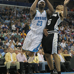 29 March 2009: New Orleans Hornets guard Devin Brown (23) shoots over San Antonio Spurs forward Ime Udoka (5) during a NBA game between Southwestern Conference rivals the New Orleans Hornets and the San Antonio Spurs at the New Orleans Arena in New Orleans, Louisiana.
