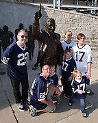 Sept 19, 2009; State College, PA, USA; The Frye family poses for a photo with a statue of Penn State head coach Joe Paterno outside of Beaver Stadium.  Mandatory Credit: Jason Miller-US PRESSWIRE