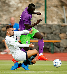 Famara Diedhiou of Bristol City is tackled - Mandatory by-line: Matt McNulty/JMP - 22/07/2017 - FOOTBALL - Tenerife Top Training - Costa Adeje, Tenerife - Bristol City v Atletico Union Guimar  - Pre-Season Friendly