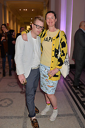 SID BRYAN and COZETTE McCREERY at a VIP preview of the V&A's new exhibition 'The Glamour of Italian Fashion' - a comprehensive look at Italian Fashion from 1945-2014 held at The Victoria & Albert Museum, London on 2nd April 2014.