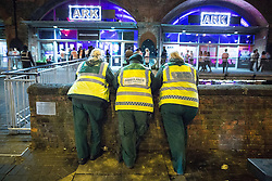 """© Licensed to London News Pictures . 16/11/2015 . Manchester , UK . Medics on standby at the event . Annual student pub crawl """" Carnage """" at Manchester's Deansgate Locks nightclubs venue . The event sees students visit several clubs over the course of an evening . This year's theme is """" Animal Instinct - unleash your beast """" . Photo credit : Joel Goodman/LNP"""