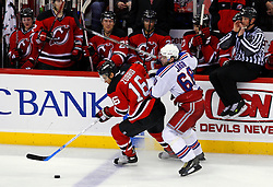 February 1, 2008; Newark, NJ, USA; New Jersey Devils center Dainius Zubrus (16) skates away from New York Rangers right wing Jaromir Jagr (68) during the third period at the Prudential Center in Newark, NJ.  The Rangers defeated the Devils 3-1.