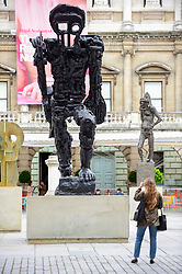 © Licensed to London News Pictures. 31/05/2019. LONDON, UK.  A woman views a major installation of six recent sculptures by celebrated artist Thomas Houseago is unveiled in the courtyard of the Royal Academy of Arts in Piccadilly.  The installation forms part of The Summer Exhibition which runs 10 June to 12 August 2019.  Photo credit: Stephen Chung/LNP