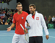 Jerzy Janowicz and Lukasz Kubot of Poland compete during the third day the BNP Paribas Davis Cup 2013 between Poland and Slovenia at Hala Stulecia in Wroclaw on February 3, 2013..Photo by: Piotr Hawalej