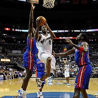 28 March 2009:   Washington Wizards guard Gilbert Arenas (0) goes to the basket and scores in the 1st quarter against Detroit Pistons center Kwame Brown (38) and center Antonio McDyess (24) at the Verizon Center in Washington, D.C.  Arenas played his first game of the season and finished with 15 points and 10 assists as the Pistons defeated the Wizards 98-96..