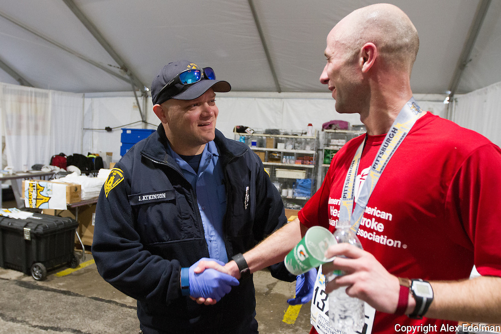 Jeff greets Paramedic John in the medical tent following the 2016 race. John was anxious to see Jeff and hand over some Pittsburgh EMS gear for Jeff to wear.