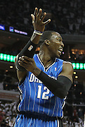 CHARLOTTE - APRIL 24:  Center Dwight Howard #12 of the Orlando Magic argues with the referee (not pictured) during Game Three of the Eastern Conference Quarterfinals against the Orlando Magic during the 2010 NBA Playoffs at Time Warner Cable Arena on April 24, 2010 in Charlotte, North Carolina. NOTE TO USER: User expressly acknowledges and agrees that, by downloading and/or using this photograph, user is consenting to the terms and conditions of the Getty Images License Agreement.  (Photo by Mike Zarrilli/Getty Images) *** Local Caption *** Dwight Howard
