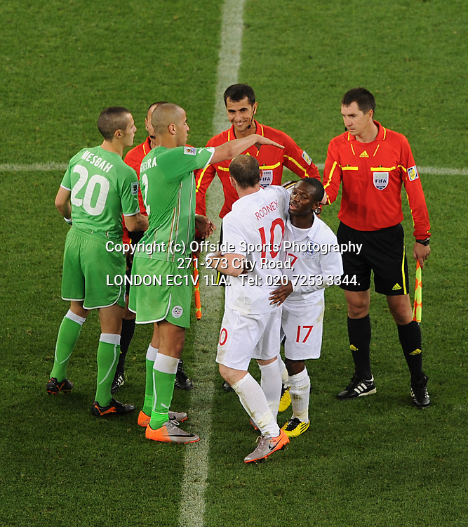 18/06/2010 World Cup. England v Algeria.<br /> Shaun Wright-Phillips pulls Wayne Rooney away from a confrontation with the referee.<br /> Photo: Mark Leech.