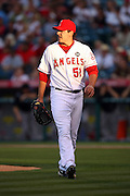 ANAHEIM, CA - JUNE 24:  Starting pitcher Joe Saunders #51 of the Los Angeles Angels of Anaheim walks back to the dugout in the late day sun during the game against the Colorado Rockies at Angel Stadium on Wednesday, June 24, 2009 in Anaheim, California.  The Angels defeated the Rockies 11-3.  ©Paul Anthony Spinelli*** Local Caption *** Joe Saunders