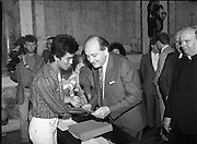 Vietnamese Refugees are Naturalised.  (R61)..1987..08.07.1987..07.08.1987..8th July 1987..A large group of Vietnamese refugees were presented with certificates of naturalisation by Justice Minister, Gerard CollinsTD at the dept of Foreign Affairs in Iveagh House today. The vietnamese were dispossed due to the Vietnam war.The group ,consisting of 156 adults, arrived in Ireland from Vietnam and some refugee camps inHong Kong and Malaysia...Image shows Minister Gerard Collins presenting the certificates of naturalisation to the Vietnamese adults in Iveagh House, Dublin.