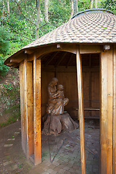 Sculpture of Madonna and child in the wooden chapel at Greencombe Gardens, Somerset