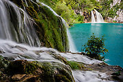 Waterfalls tumble into turquoise lakes in Plitvice National Park, Croatia
