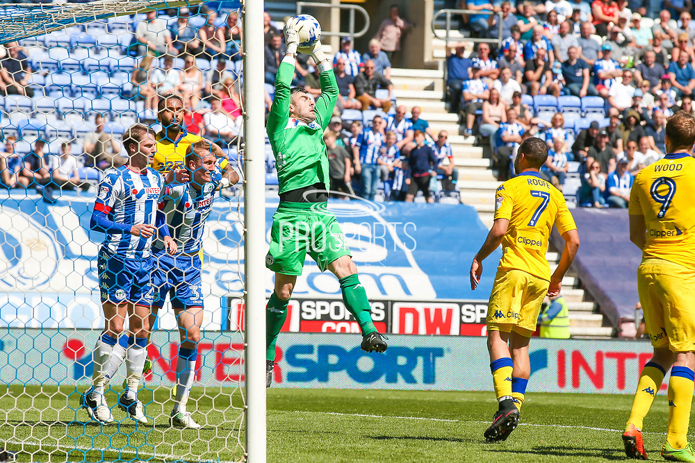 Wigan Athletic  goalkeeper Matthew Gilks (35)  claims the ball during the EFL Sky Bet Championship match between Wigan Athletic and Leeds United at the DW Stadium, Wigan, England on 7 May 2017. Photo by Simon Davies.