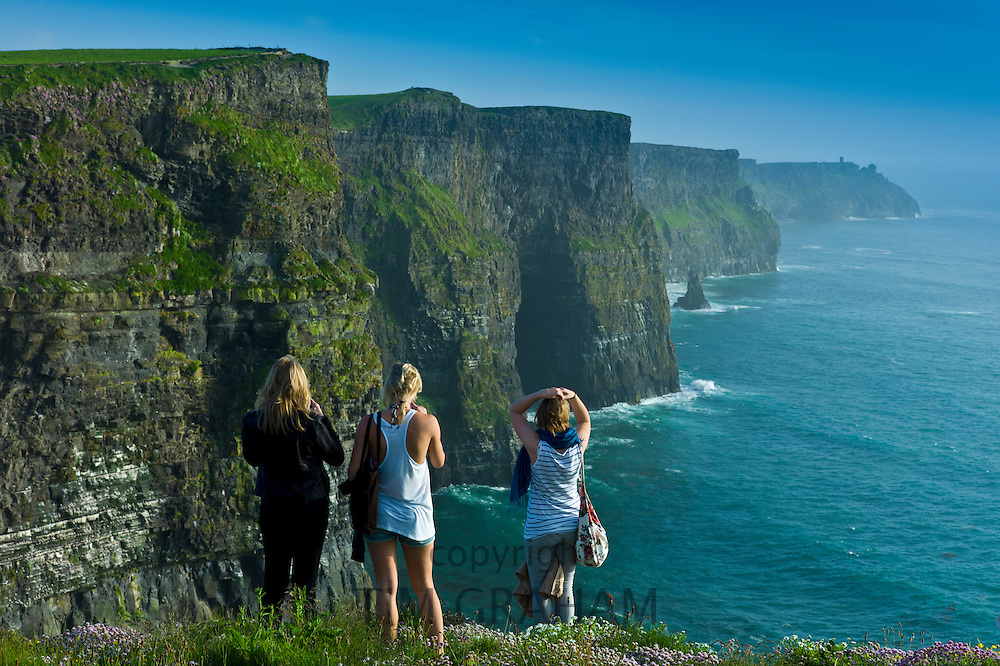 Tourists at the Cliffs of Moher, famous tourist landmark, County Clare, Ireland RESERVED USE - NOT FOR DOWNLOAD -  FOR USE CONTACT TIM GRAHAM
