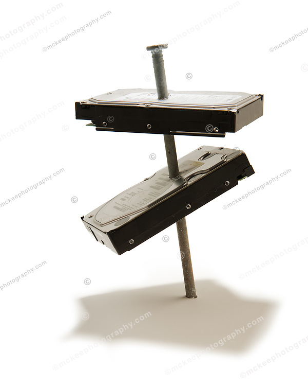 Harddrives stuck on a metal spike and nailed into the table. Data is destroyed.