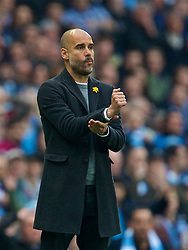 MANCHESTER, ENGLAND - Saturday, April 7, 2018: Manchester City's manager Pep Guardiola appeals for a hand-ball during the FA Premier League match between Manchester City FC and Manchester United FC at the City of Manchester Stadium. (Pic by David Rawcliffe/Propaganda)