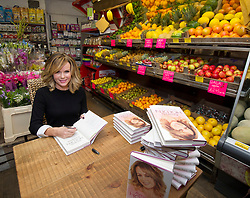Amanda Holden autobiography signing.<br /> Amanda Holden signing her autobiography at the village grocers 'Hylands' where she once worked in her hometown of Bishops Waltham, United Kingdom, Wednesday, 6th November 2013. Picture by i-Images