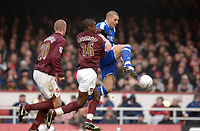 Photo: Daniel Hambury.<br />Arsenal v Cardiff City. The FA Cup. 07/01/2006.<br />Cardiff's Darren Purse gets ahead of Arsenal's Philippe Senderos (L) and Johan Djourou.