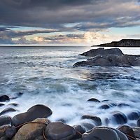 Greymare Rock at Dusk Dunstanburgh Northumberland Coast England