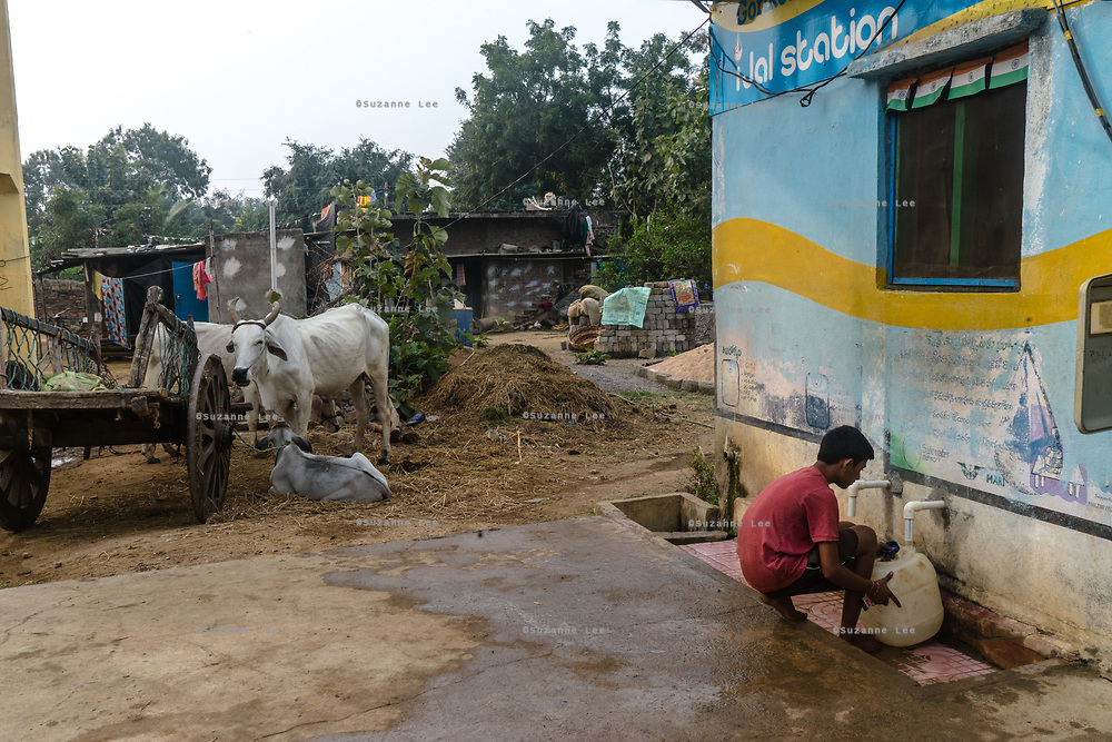 A boy fills a plastic can of water using a tap at a Safe Water Network iJal station in village Gorikothapally, Telangana, Indiia, on Friday, February 8, 2019. Photographer: Suzanne Lee for Safe Water Network