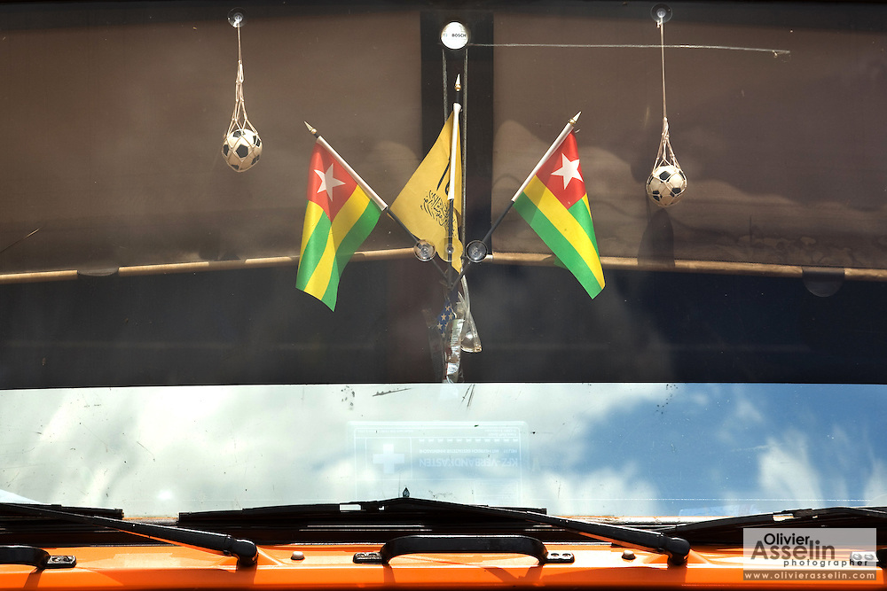 Togolese flags and miniature footballs hang from the windshield of a large truck at the Terminal du Sahel, a large truck terminal in Lome, Togo on Wednesday October 1, 2008.