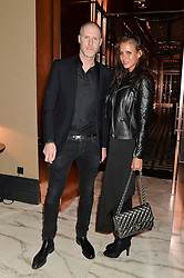 JEAN-DAVID MALAT and EKATERINA KITAINA at the Installation And Reveal Of Gerald Scarfe's Exclusive Artworks In Scarfes Bar at the Rosewood Hotel, 252 High Holborn, London on 7th April 2014.