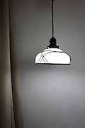 hanging from ceiling glass lamp shade with light on