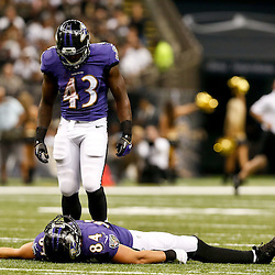 Aug 28, 2014; New Orleans, LA, USA; Baltimore Ravens running back Fitzgerald Toussaint (43) looks over injured tight end Phillip Supernaw (84)  during the first half of a preseason game at Mercedes-Benz Superdome. Mandatory Credit: Derick E. Hingle-USA TODAY Sports