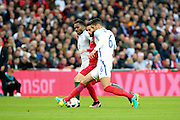 England defender, Chris Smalling (06) stopping Portugal midfielder, Rafa Silva (18) during the Friendly International match between England and Portugal at Wembley Stadium, London, England on 2 June 2016. Photo by Matthew Redman.