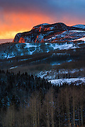 A winter sunset on the snow-covered Brazos Cliffs near Chama, New Mexico.