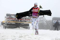 28.12.2011, DKB-Ski-ARENA, Oberhof, GER, Viessmann FIS Tour de Ski 2011, Training, im Bild ein Teammitglied verlässt die DKB-Ski-Arena, im Hintergrund eine Pistenraupe . during of Viessmann FIS Tour de Ski 2011, in Oberhof, GERMANY, 2011/12/28. EXPA Pictures © 2011, PhotoCredit: EXPA/ nph/ Hessland..***** ATTENTION - OUT OF GER, CRO *****