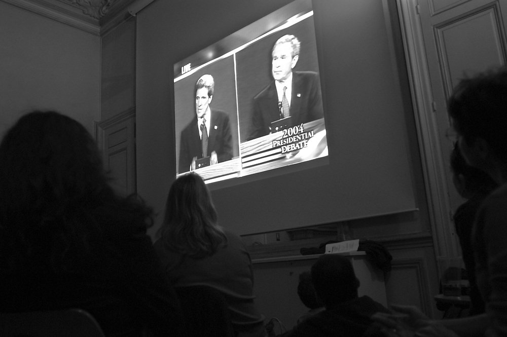 Americans living in Paris attend a screening of the first presidential debate between George Bush and John Kerry, organized by Democrats Abroad at the American University in Paris. .Paris, France. 01/10/2004.Photo © J.B. Russell