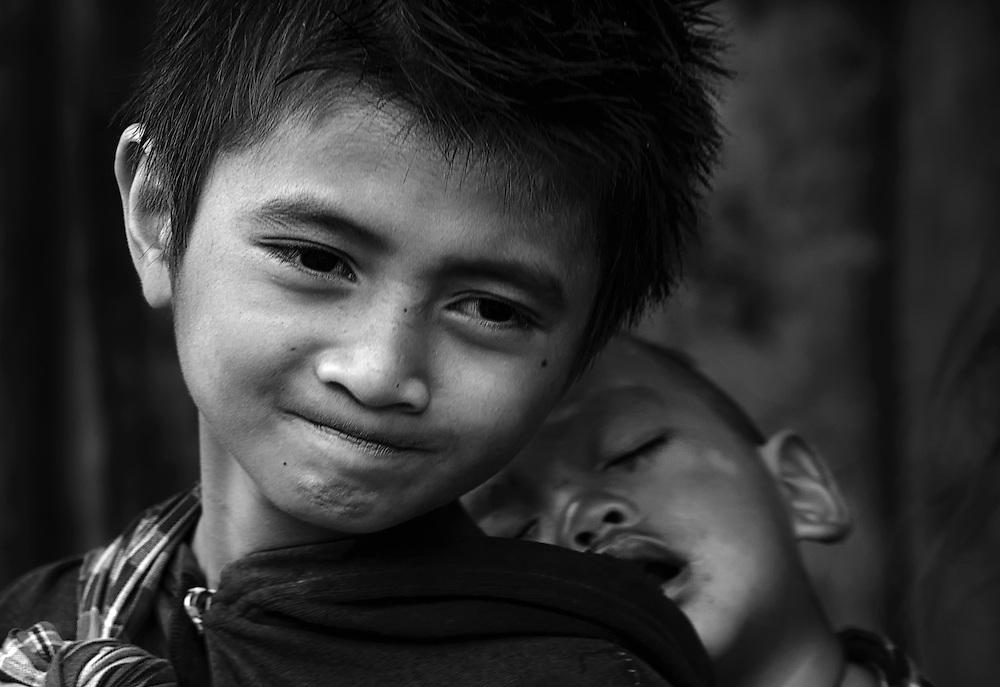 A Khamu boy with his brother near Luang Prabang, Laos.