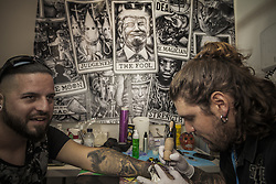 October 5, 2018 - Barcelona, Catalonia, Spain - Tattoo artist makes a tattoo in the 21st tattoo and urban culture Expo in Barcelona. (Credit Image: © Celestino Arce Lavin/ZUMA Wire)
