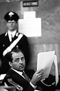 """Antonio Di Pietro, Public Prosecutor, during a hearing of the trial """"Discariche"""" (Dumps) in Milan, May 3, 1994. © Carlo Cerchioli..Antonio Di Pietro, pubblico ministero, durante un'udienza del processo Discariche a Milano, 3 maggio 1994."""