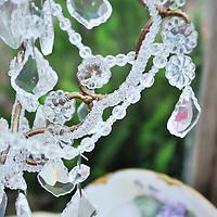 Vintage garden: Detail of chandelier crystals inside glass shed