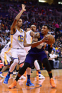 Feb 10, 2016; Phoenix, AZ, USA; Phoenix Suns guard Orlando Johnson (0) handles the ball against Golden State Warriors guard Shaun Livingston (34) at Talking Stick Resort Arena. Mandatory Credit: Jennifer Stewart-USA TODAY Sports