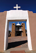 Old adobe St. Jeromechurch with white crosses at Taos Pueblo, Taos, New Mexico, USA