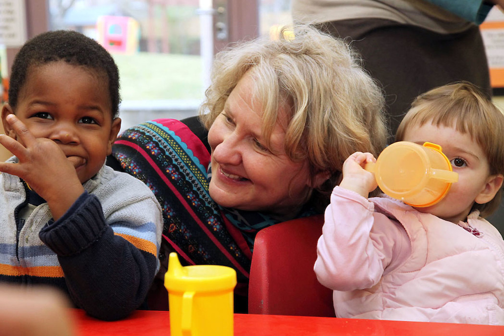 Minister Helen Goodman MP at Surestart Shepherds Bush..With Adea Musa (20 months) and Emmanuel Byam 2 and a half)..Copyright: Jonathan Goldberg