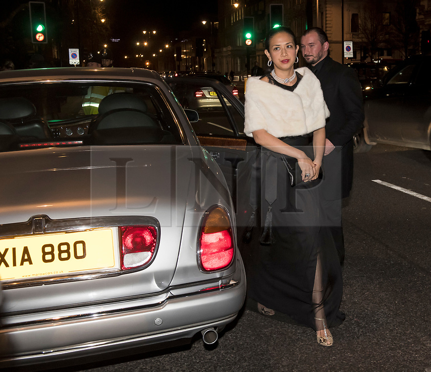 © Licensed to London News Pictures. 07/02/2018. London, UK.  A guest driven in a Rolls Royce, arrives at the Natural History Museum in London for the annual Black and White Ball, a fundraiser held by the Conservative Party. Photo credit: Ben Cawthra/LNP