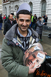 A supporter of James Matthews  with #IamJim masks at Westminster Magistrates Court where Matthews faces a charge of attending a place used for terrorist training, under the Terrorism Act 2006, after fighting against ISIS with the Kurdish YPG militia. London, February 14 2018.