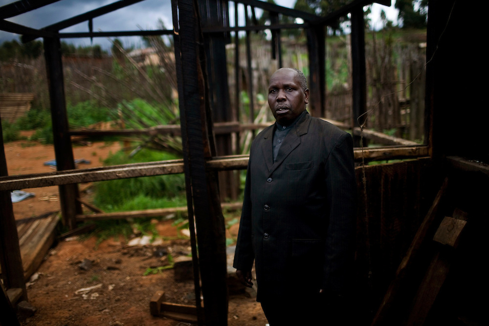 Martin Njoroge, a pastor in Morindoko, sees his destroyed home for the first time after spending 4 months in an IDP camp. Four months after post election violence caused 300,000 Kenyans to leave their homes, the long process to resettle has begun. In Molo, a town in Kenya's Rift Valley where most of the violence occured, thousands of people returned to their homes with little or nothing to build upon.  .