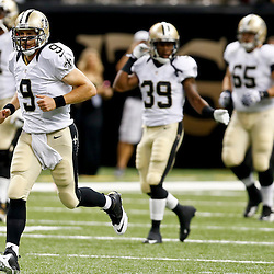 Aug 16, 2013; New Orleans, LA, USA; New Orleans Saints quarterback Drew Brees (9) before a preseason game against the Oakland Raiders at the Mercedes-Benz Superdome. Mandatory Credit: Derick E. Hingle-USA TODAY Sports