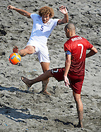 Portugal captain Madjer and Valentine of the USA battle for possession at the Copa Pilsener 2016.