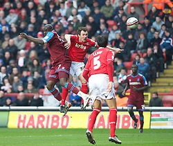 LONDON, ENGLAND - Saturday, March 5, 2011: Tranmere Rovers' Enoch Showunmi and Charlton Athletic's Christian Dailly both challenge in the air for the ball during the Football League One match at The Valley. (Photo by Gareth Davies/Propaganda)