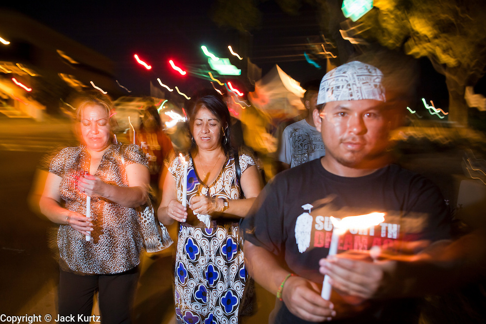 """Sept. 19 - PHOENIX, AZ: People light candles and march to Sen John McCain's office to support the DREAM Act in Phoenix Sunday night. About 30 people met in front of US Sen. John McCain's office in Phoenix Sunday night to demonstrate in support of the DREAM Act, which is scheduled to be debated in the US Senate on Tuesday, Sept 21. The Development, Relief and Education for Alien Minors Act (The """"DREAM Act"""") is a piece of proposed federal legislation in the United States that was introduced in the United States Senate, and the United States House of Representatives on March 26, 2009. This bill would provide certain illegal immigrant students who graduate from US high schools, who are of good moral character, arrived in the U.S. as minors, and have been in the country continuously for at least five years prior to the bill's enactment, the opportunity to earn conditional permanent residency. In the early part of this decade McCain supported legislation similar to the DREAM Act, but his position on immigration has hardened in the last two years and he no longer supports it. The protesters, mostly area students, marched and drilled to show their support for the US military and then held a candle light vigil.   Photo by Jack Kurtz"""