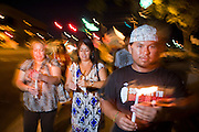 "Sept. 19 - PHOENIX, AZ: People light candles and march to Sen John McCain's office to support the DREAM Act in Phoenix Sunday night. About 30 people met in front of US Sen. John McCain's office in Phoenix Sunday night to demonstrate in support of the DREAM Act, which is scheduled to be debated in the US Senate on Tuesday, Sept 21. The Development, Relief and Education for Alien Minors Act (The ""DREAM Act"") is a piece of proposed federal legislation in the United States that was introduced in the United States Senate, and the United States House of Representatives on March 26, 2009. This bill would provide certain illegal immigrant students who graduate from US high schools, who are of good moral character, arrived in the U.S. as minors, and have been in the country continuously for at least five years prior to the bill's enactment, the opportunity to earn conditional permanent residency. In the early part of this decade McCain supported legislation similar to the DREAM Act, but his position on immigration has hardened in the last two years and he no longer supports it. The protesters, mostly area students, marched and drilled to show their support for the US military and then held a candle light vigil.   Photo by Jack Kurtz"