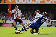 Ipswich striker Daryl Murphy (9) in a 3 way tackle during the EFL Sky Bet Championship match between Brentford and Ipswich Town at Griffin Park, London, England on 13 August 2016. Photo by Matthew Redman.
